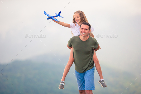 Beautiful happy family in mountains in the background of fog - Stock Photo - Images