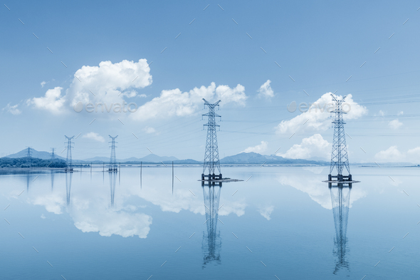 electricity transmission pylon on lake - Stock Photo - Images