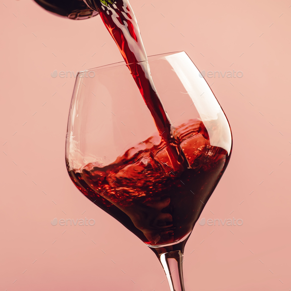 French dry red wine, pours into glass - Stock Photo - Images