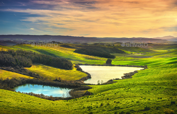 Tuscany, small lakes and rural landscape on sunset, Siena Italy. - Stock Photo - Images