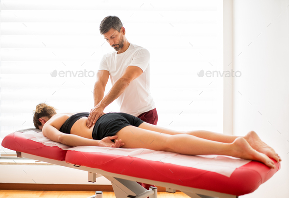 Osteopath doing paravertebral treatment - Stock Photo - Images