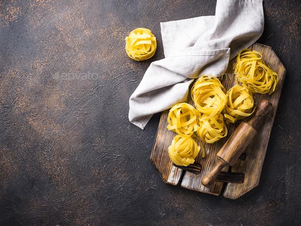 Raw pasta tagliatelle or fettuccine - Stock Photo - Images