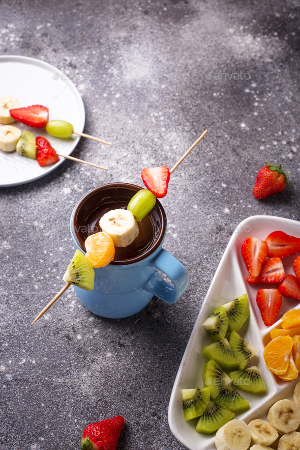 Sweet chocolate fondue with fruits - Stock Photo - Images
