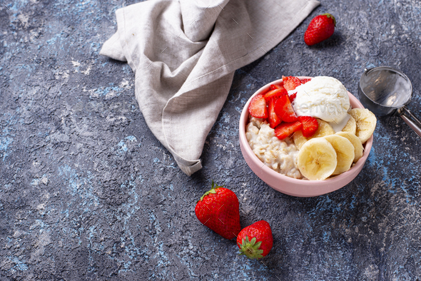 Oatmeal with strawberry, banana and ice cream - Stock Photo - Images