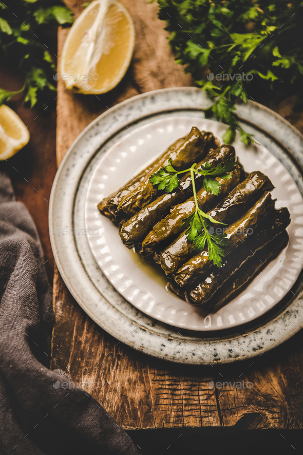 Turkish traditional Dolma with rice and spices over wooden background - Stock Photo - Images