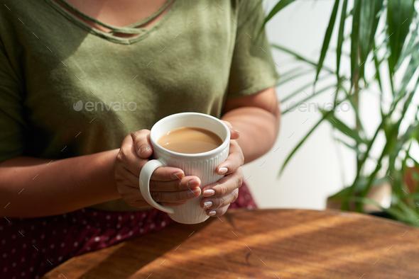 Enjoying Coffee at Cozy Cafe - Stock Photo - Images