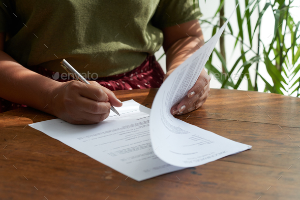 Female Entrepreneur Signing Contract - Stock Photo - Images