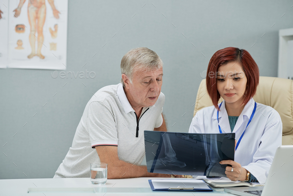 Radiologist showing x-ray - Stock Photo - Images