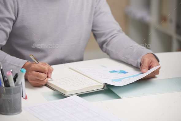 Working with financial report - Stock Photo - Images