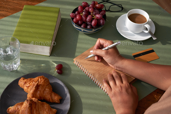 Taking Notes at Breakfast - Stock Photo - Images