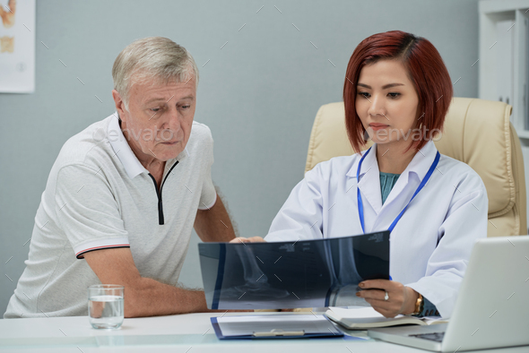 Explaining x-ray results - Stock Photo - Images