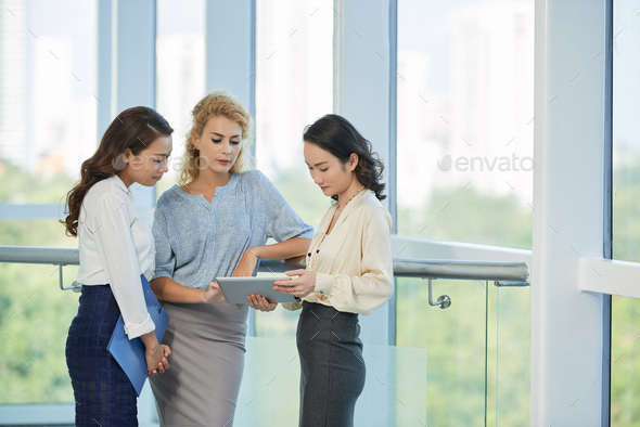 Business woman discussing data on the screen - Stock Photo - Images