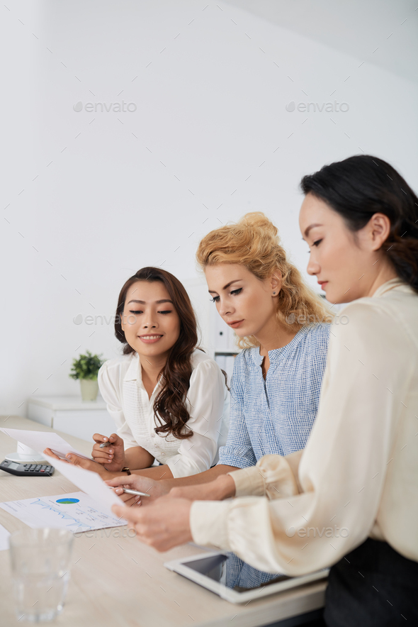 Discussing financial report - Stock Photo - Images