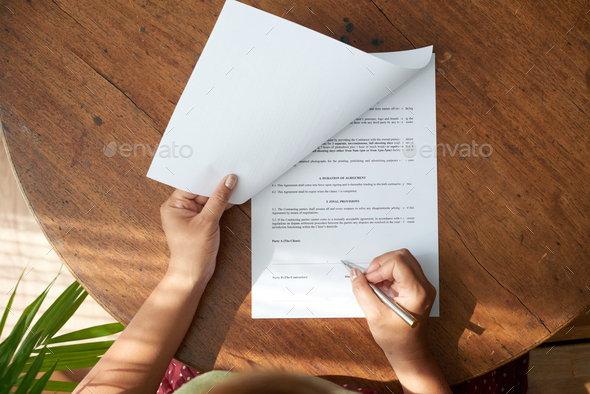 Businesswoman Studying Contract - Stock Photo - Images