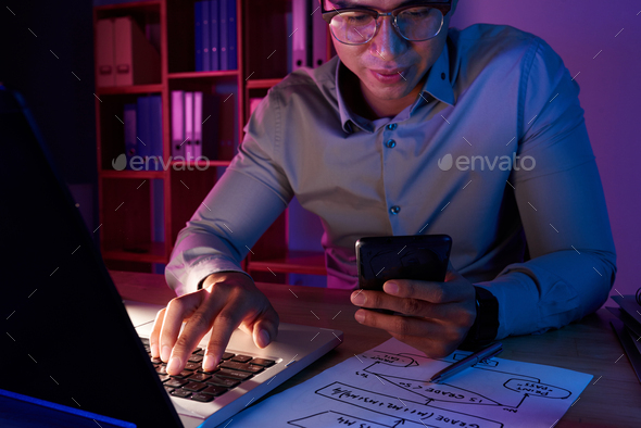 Asian Programmer Working on Computer App - Stock Photo - Images