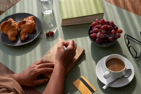Taking Notes at Kitchen Table - Stock Photo - Images
