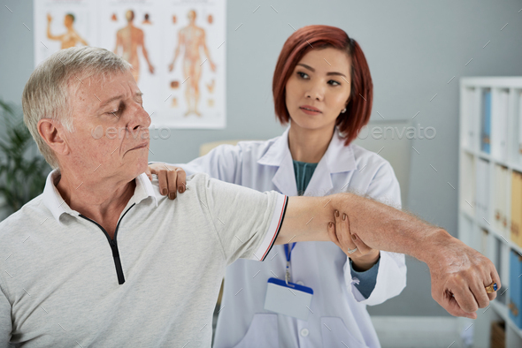 Working with elderly patient - Stock Photo - Images