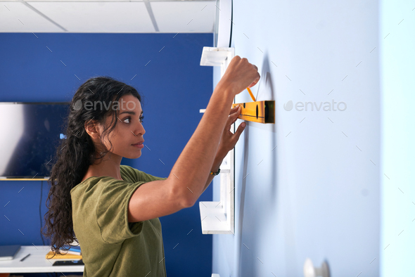 Marking the wall - Stock Photo - Images
