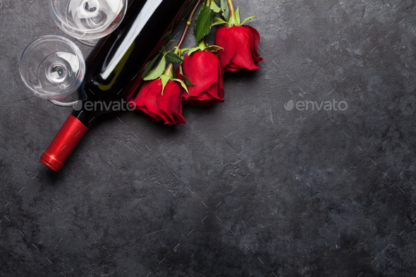 Valentines day card with rose flowers bouquet and wine - Stock Photo - Images
