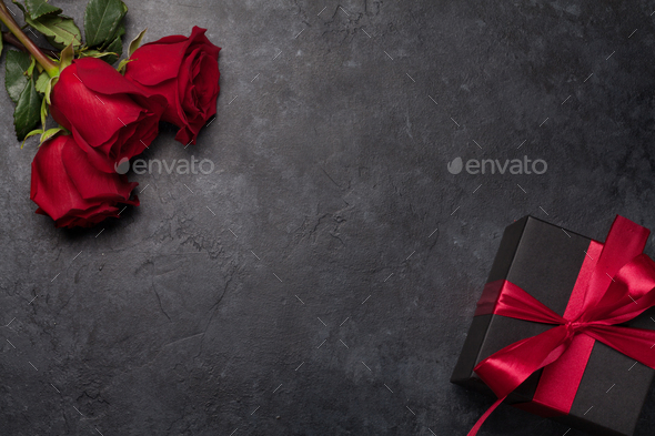 Valentines day gift box and roses bouquet - Stock Photo - Images