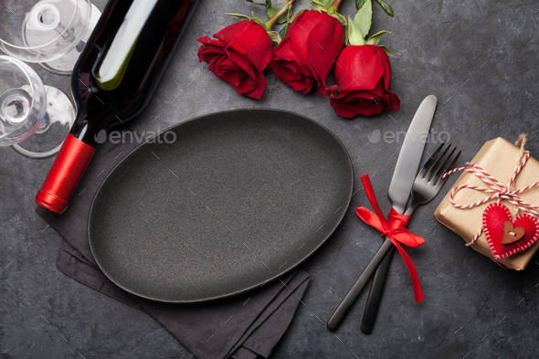 Valentines day with empty plate, gift, wine and roses - Stock Photo - Images