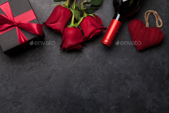 Valentines day gift box, wine and roses - Stock Photo - Images