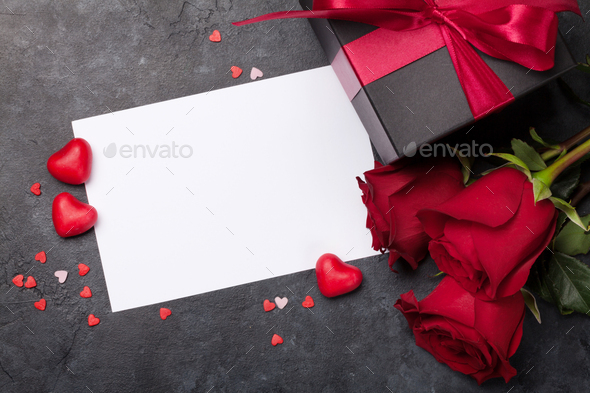 Valentines day card with gift box and rose flowers - Stock Photo - Images