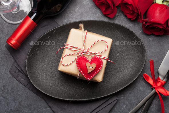 Valentines day with gift, wine and roses - Stock Photo - Images