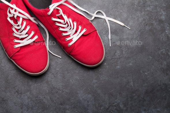 Pair of red sneakers over stone - Stock Photo - Images