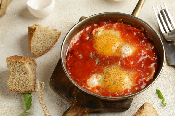 Fried Eggs in Tomato Sauce - Stock Photo - Images