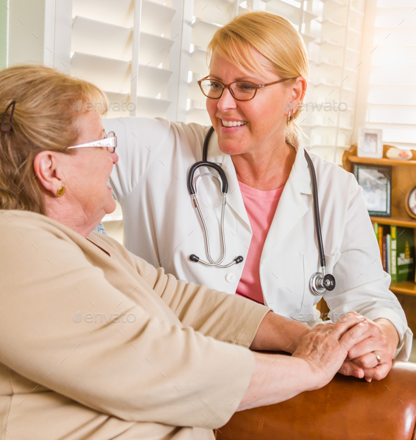 Happy Smiling Doctor or Nurse Talking to Senior Woman in Chair At Home - Stock Photo - Images