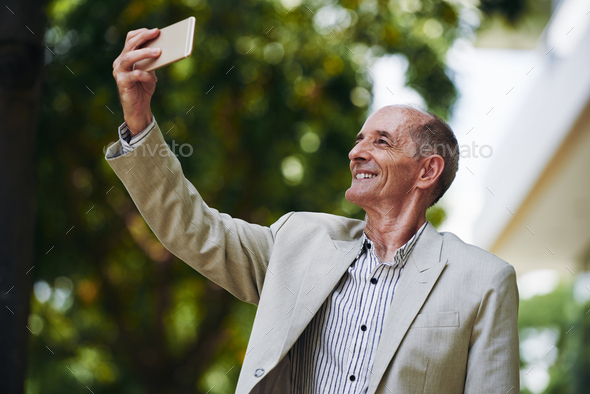 Photographing old man - Stock Photo - Images