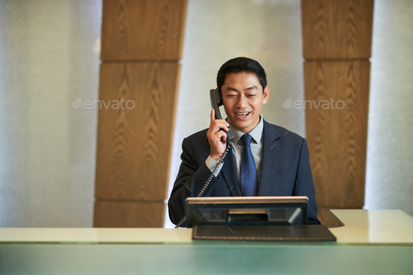Vietnamese receptionist - Stock Photo - Images