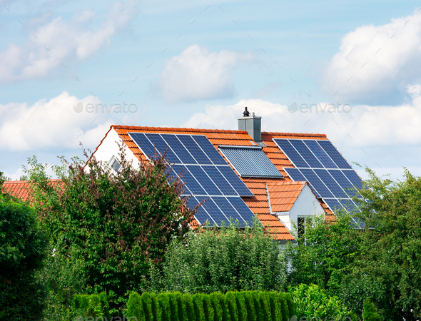 Modern House with Photovoltaic and Solar Heating System - Stock Photo - Images