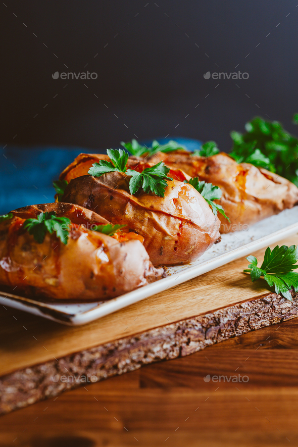 Baked three sweet potatoes with fresh parsley - Stock Photo - Images