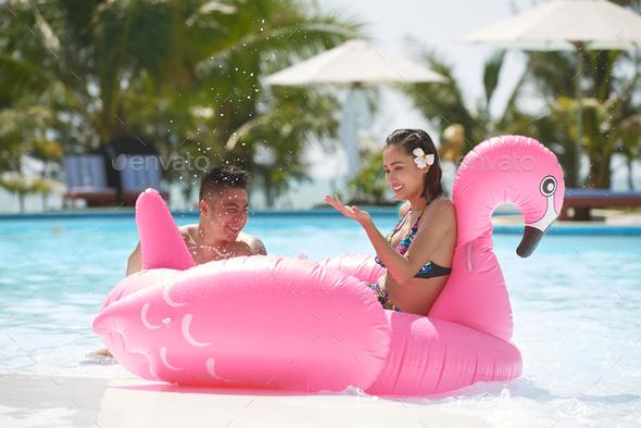 Joyful couple in pool - Stock Photo - Images