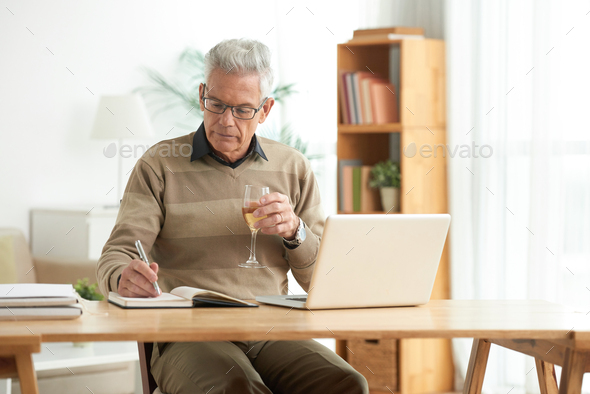 Working and drinking wine - Stock Photo - Images