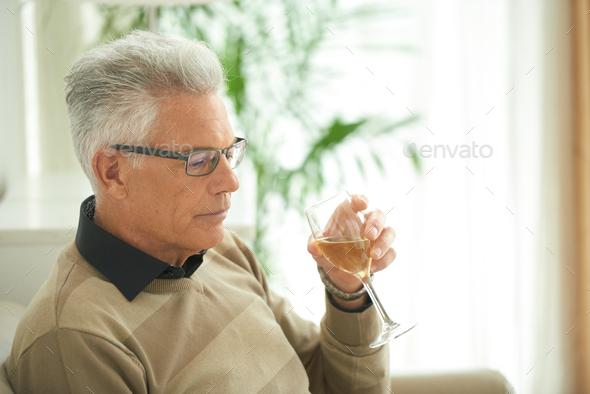 Enjoying glass of wine - Stock Photo - Images