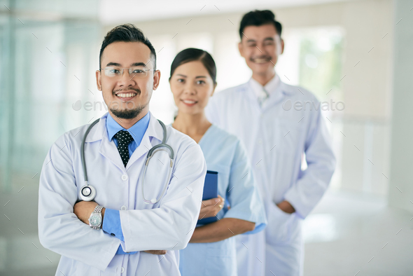 Smiling general practitioner - Stock Photo - Images
