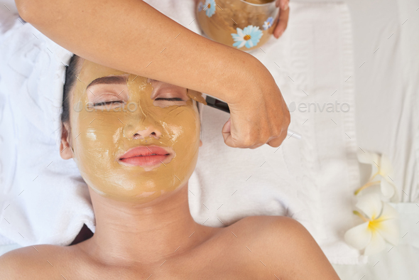 Applying clay mask - Stock Photo - Images
