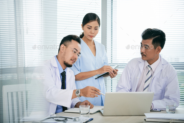 Discussing treatment options - Stock Photo - Images