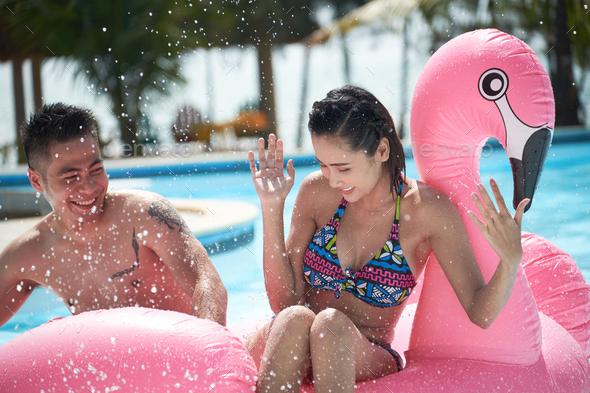 Splashing couple - Stock Photo - Images