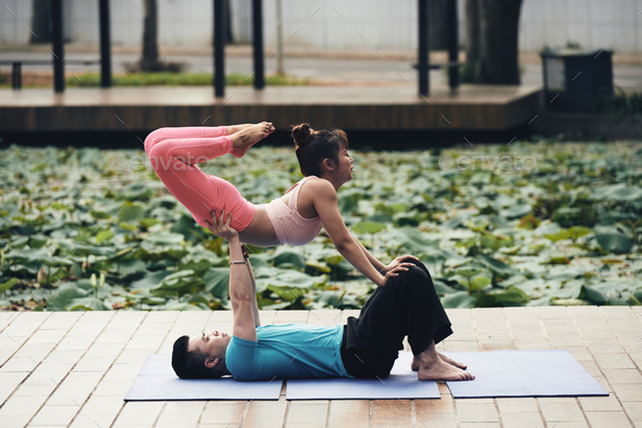 Couple doing yoga - Stock Photo - Images
