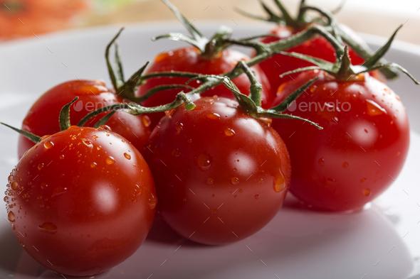 fresh raw cherry tomatoes - Stock Photo - Images