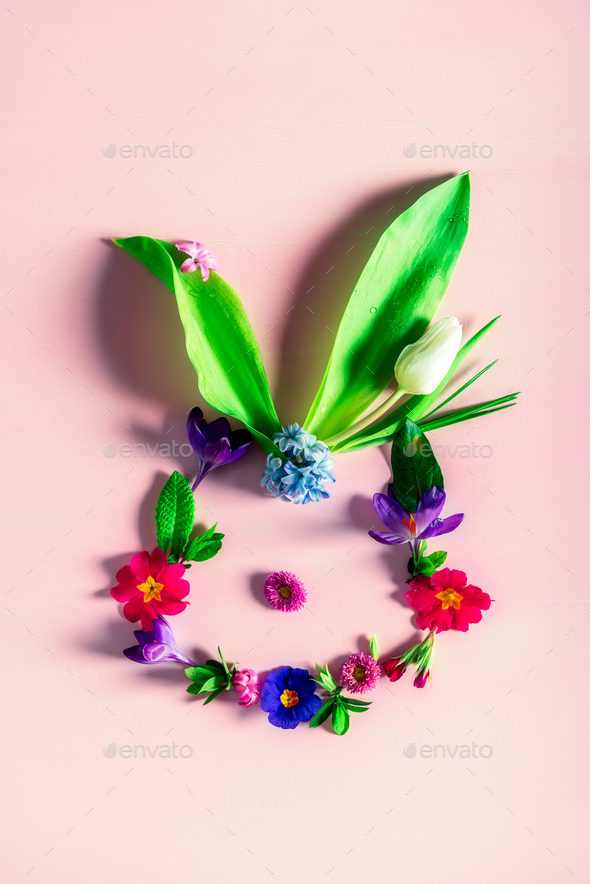 Easter minimal concept. Bunny shape made from spring flowers - Stock Photo - Images