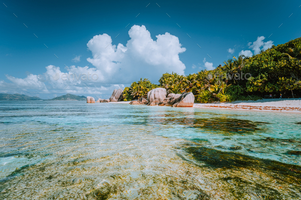 Anse Source d'Argent - Paradise beach with bizarre rocks, shallow lagoon water on La Digue - Stock Photo - Images