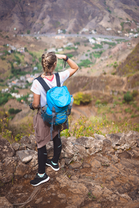 Woman tourist on cobbled path looking over picturesque village Coculi. Santo Antao, Cabo Verde - Stock Photo - Images