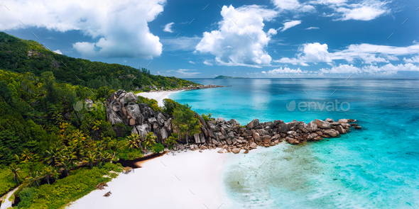 Aerial panoramic view of beautiful Grand Anse beach on La Digue island in Seychelles. Granite - Stock Photo - Images