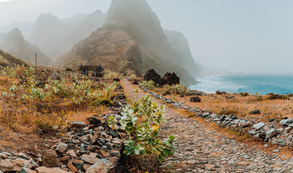 Panoramic view of stony hiking path to Ponta do Sol over amazing arid Aranhas valley with huge - Stock Photo - Images