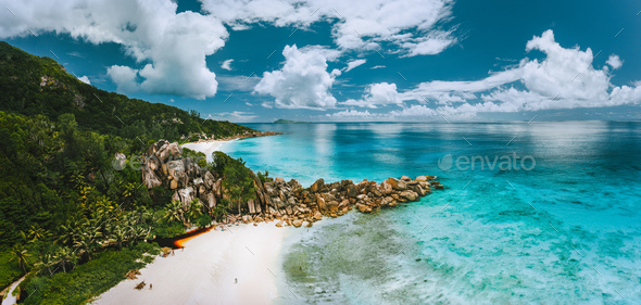 Aerial panoramic view of beautiful Grand Anse beach on La Digue island in Seychelles - Stock Photo - Images